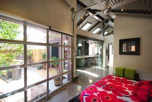 Bungalow Home with Industrial Design Master Bedroom garage Design | Renovation Design Group