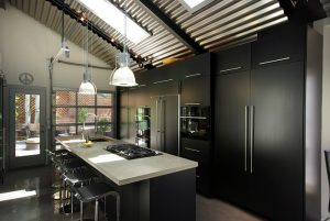 skylights and window natural light, glass table, rug   Renovation Design Group