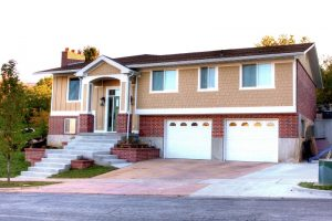 After Exterior Front of Split Entry Home with Garage Remodel | Renovation Design Group