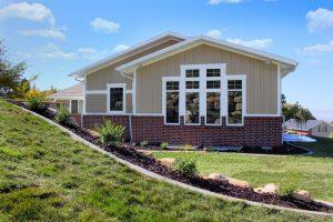 After Exterior Window Remodels new Windows Split Entry Home exterior | Renovation Design Group