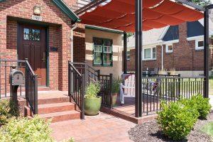After, Exterior, front porch, pergolas, sun shades | Renovation Design Group