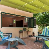 After, Exterior, back porch, pergolas, sun shades | Renovation Design Group