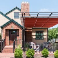 After, Exterior, front porch, pergolas, sun shades | Renovation Design Group