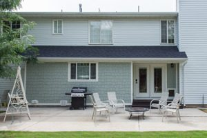 Before back patio exterior Small, smart additions to your home can replace big ones article | Renovation Design Group