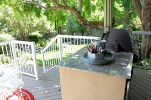After_Exterior Renovation_Custom Grill_Covered Porch Designs   Renovation Design Group