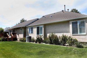 After exterior 1980's home remodel update, back exterior renovation | Renovation Design Group