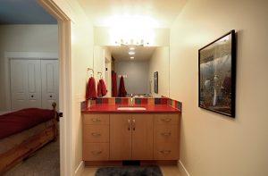 After_Interior_Bathroom Remodels_Red Vanity_Bathroom Remodeling Ideas | Renovation Design Group