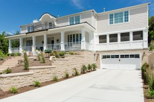 Two-story exterior remodel large front porch | Renovation Design Group