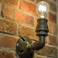 After Interior Remodels_Bathroom Brick_Industrial Lighting | Renovation Design Group