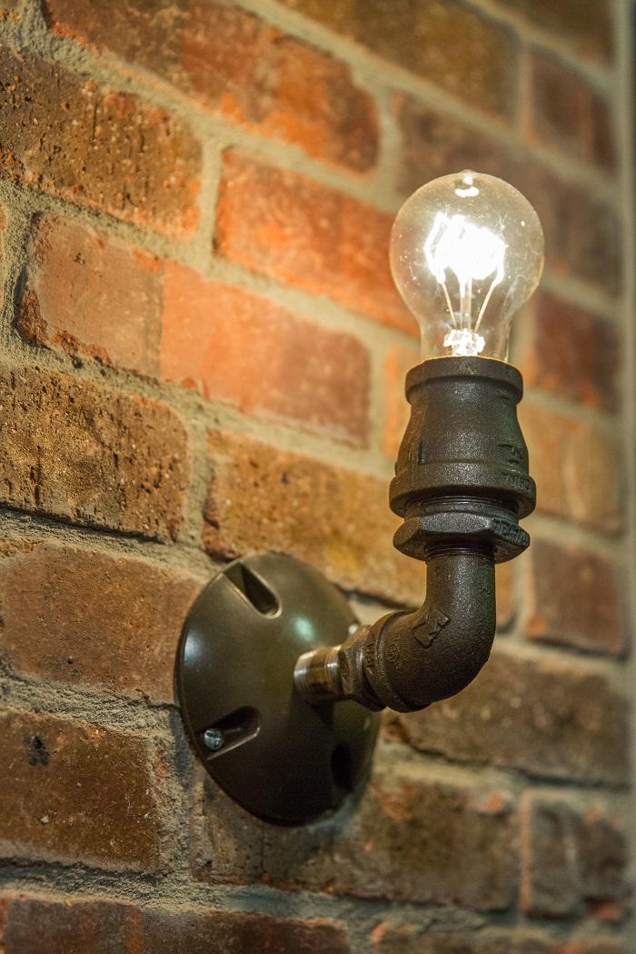 After Interior Remodels_Bathroom Brick_Industrial Lighting | Renovation Design Group