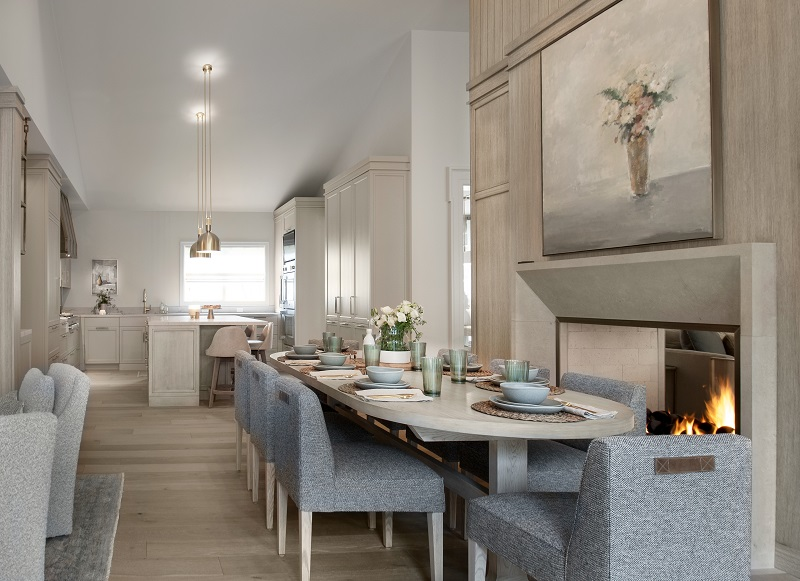 Formal dining, double open fireplace, modern color scheme, soft colors, white, tan, blues