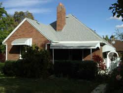 Before Side of Tudor Home Remodel Porch | Renovation Design Group