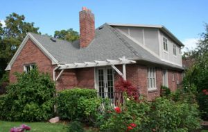 Renovated tudor with Trellis and rear tudor style dormer | Renovation Design Group