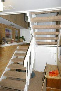 before image split level stairs After_Interior Remodel_Living Room_Family Room Design resized | Renovation Design Group