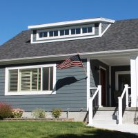 After porch cottage blue exterior small remodels | Renovation Design Group