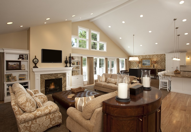 Large family room with vaulted ceilings and a fireplace | Renovation Design Group